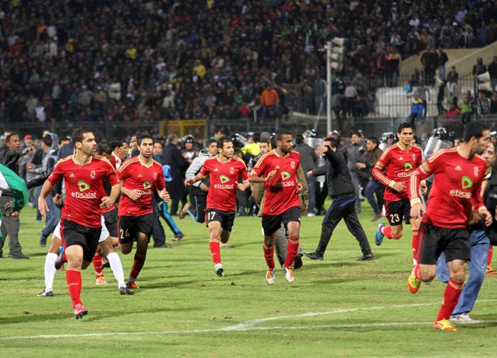 """The melee - which followed an Egyptian league match between Al-Masry, the home team in the Mediterranean city, and Al-Ahly, based in Cairo and one of Egypt's most popular teams - was the worst case of soccer violence in Egypt and the deadliest worldwide since 1996. One player said it was """"like a war."""" (AP Photo)"""