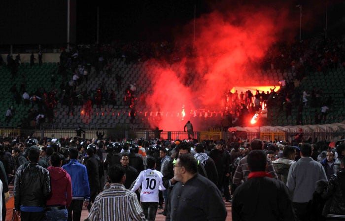 Egyptian fans rush into the field following Al-Ahly club soccer match against Al-Masry club at the soccer stadium in Port Said. (AP Photo)