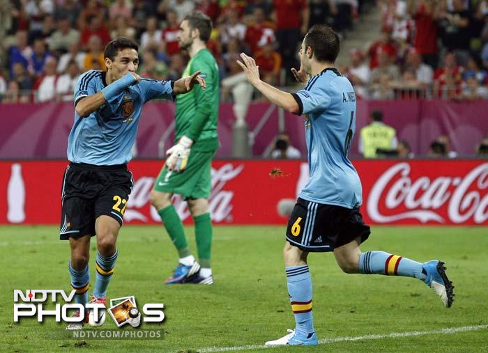 Defending champions Spain made the quarter-finals after substitute Jesus Navas hit the late winner in their 1-0 victory over Croatia, who bowed out. (All AFP and AP Images)