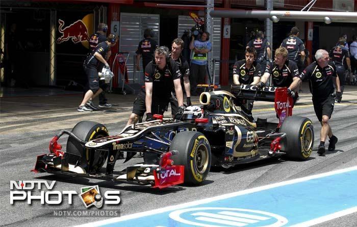 Kimi Raikkonen kept Team Lotus' flag flying high as he finished third. (AFP PHOTO / DIMITAR DILKOFF)