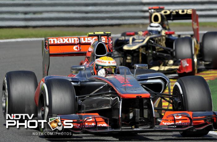 McLaren Mercedes' British driver Lewis Hamilton (L) and Lotus F1 Team's Finnish driver Kimi Raikkonen drive during the qualifying session at the Spa-Francorchamps circuit.