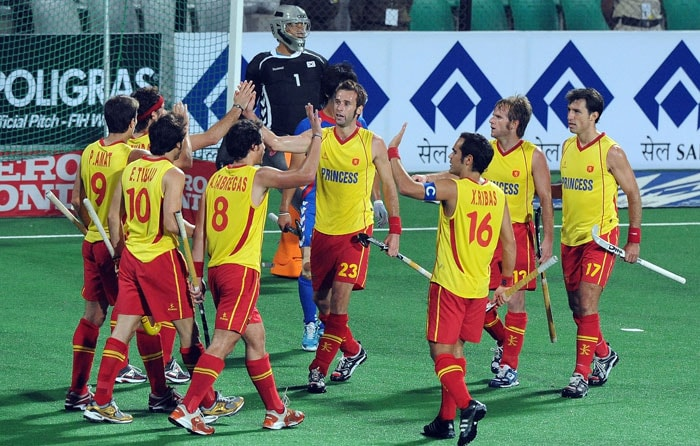 Spanish hockey players celebrates a goal against South Korea during their World Cup 2010 classification match for 5th and 6th place at the Major Dhyan Chand Stadium. (AFP Photo)