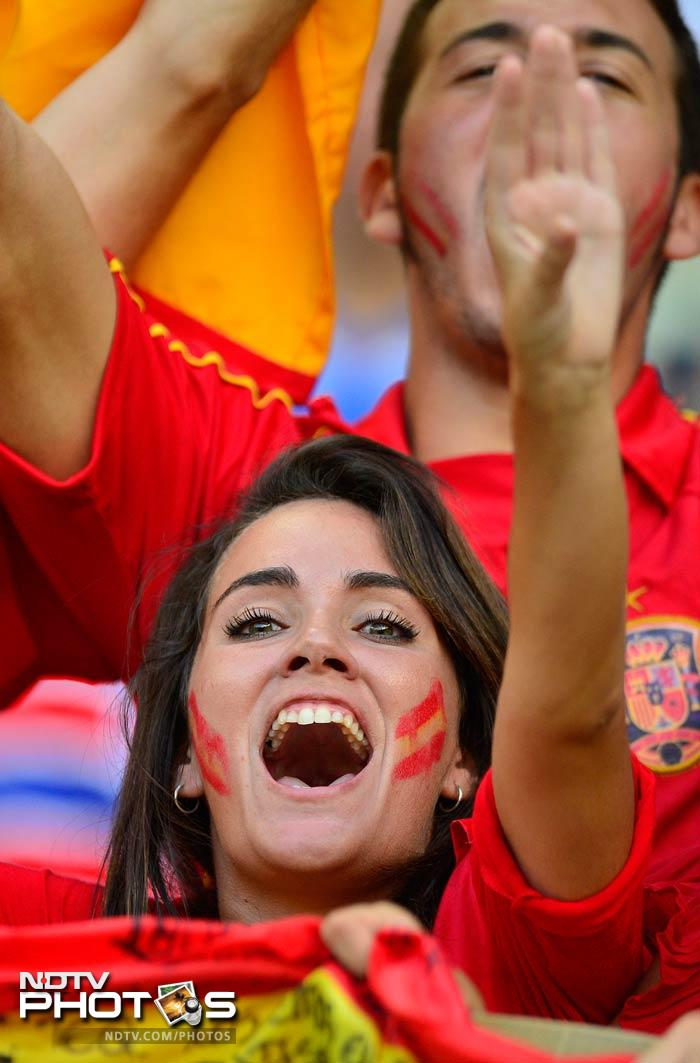 Amid cloying humidity, the intensity dropped in the second half, and Spain occasionally found themselves in the unfamiliar position of hearing their opponents' passing combinations celebrated with chants of 'Ole!'