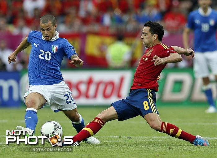 Holders Spain were held to a 1-1 draw by a dogged and determined Italy at the Arena Gdansk in the opening Group C match at the European Championship. (All AFP and AP Images)