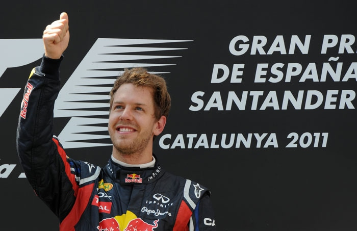 This is Vettel's 4th victory in 5 races this season and nothing seems to be stopping the German. (AFP Photo)