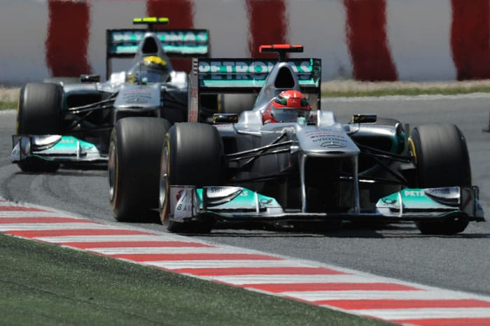 Mercedes driver Michael Schumacher finished 6th, climbing four places from his qualifying position, and outpacing his younger team-mate Nico Rosberg after a long time. Rosberg came in 7th. (AFP Photo)