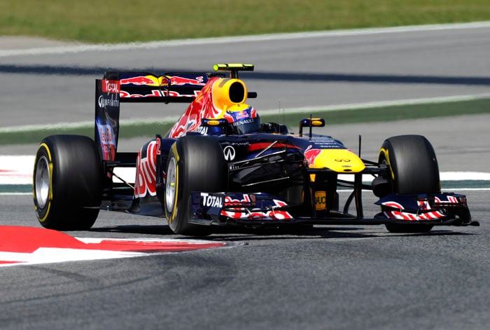 Red Bull's Mark Webber grabbed his first pole position of the season and seventh of his career after clocking the fastest time during qualifying for Sunday's Spanish Grand Prix. (AFP Photo)