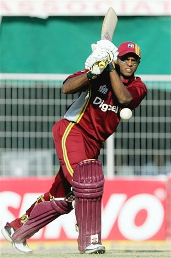 West Indies batsman Shiv Narain Chanderpaul plays a shot against India during the first one day international cricket match in Nagpur