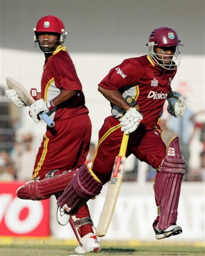 West Indies Shiv Narain Chanderpaul, right, and Brian Lara run between the wickets against India during the first one day international cricket match in Nagpur
