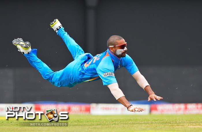 Dhawan may be seen diving here but India's fielding was quite shabby too.<br>Both Jayawardene and Tharanga were given a lifeline each.