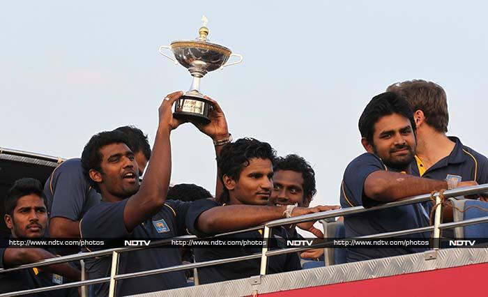 Sri Lankan cricket team which returned home from winning the Asia Cup in Bangladesh were given a rousing welcome in Colombo on Sunday. (All images from AFP and AP)