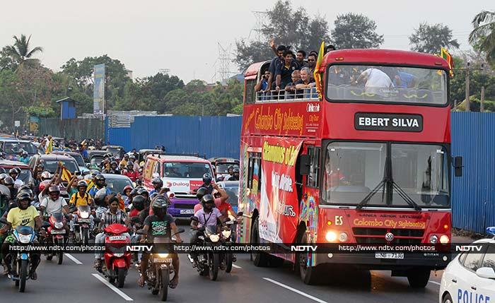 The team paraded in an open bus to the Sri Lanka Cricket headquarters where large crowds were thronged along the route from the international airport to greet the champion team.