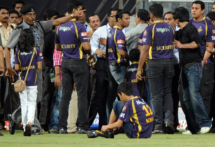 Shah Rukh Khan is seen interacting with officials while a security guard directs SRK's daughter Suhana and other kids off the playing field after the match.