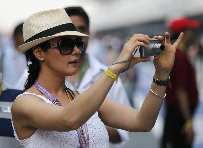 Priety Zinta is busy clicking pictures during the Indian Formula One Grand Prix
