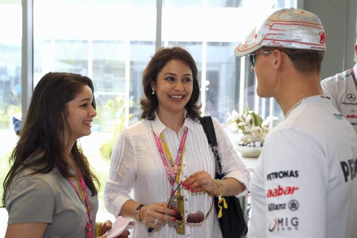 Sachin Tendulkar's wife Anjali and daughter Sarah with Michael Schumacher during the Indian Formula One Grand Prix at the Buddh International Circuit in Greater Noida