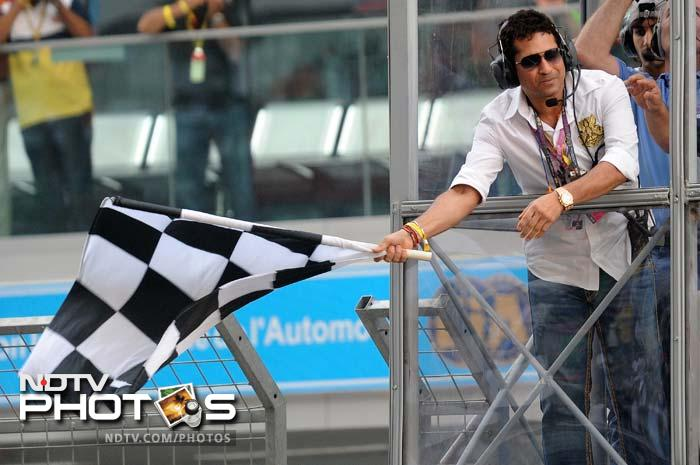 Not only was Sachin Tendulkar present at India's first F1 race, he had the honour of waving the chequered flag as Red Bull's Sebastian Vettel emerged champion.