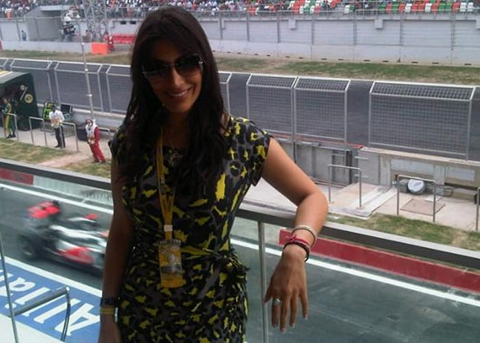 """A proud Sophie Choudry tweeted this nice photograph of herself.<br><br/> """"Right above the pit!India's first #F1 ! Friggin AWESOME! So proud!! Congrats #Vettel,"""" she wrote."""