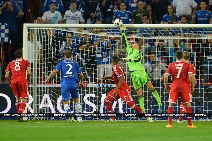 Manuel Neuer, the Bayern Munich goalkeeper makes an excellent save as Chelsea's Branislav Ivanovic looks on.