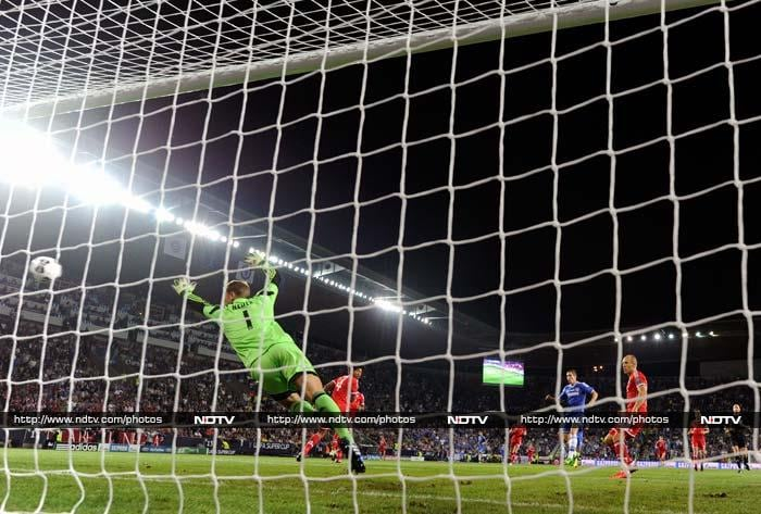 """Despite Bayern dominating possession, Chelsea went ahead after eight minutes when Germany winger Andre Schurrle's cross was volleyed into the top right corner by Torres. <br><br> In the build-up, Guardiola dubbed Mourinho """"the master of quick counter-attacks"""" and Chelsea proved his point as Branislav Ivanovic's throw-on was swept downfield by Hazard to Schurrle, then Torres as the Blues covered 80 metres in 13 seconds."""