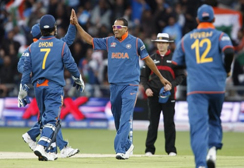 Yusuf Pathan celebrates with teammates after taking the wicket of Tamim Iqbal for 15 during their ICC World Twenty20 match at Trent Bridge cricket ground, Nottingham. (AP Photo)