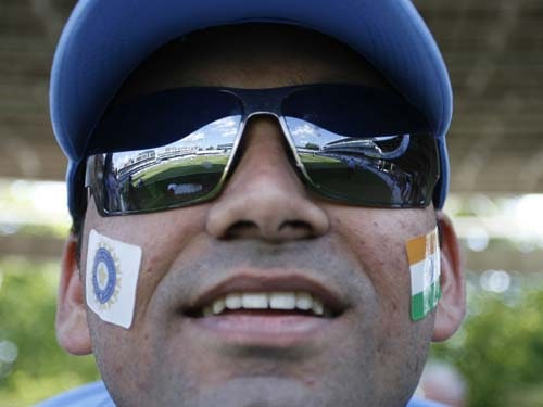 An Indian supporter watches the Indian team before a warm up match against New Zealand at Lord's in London on Monday. (AFP Photo)