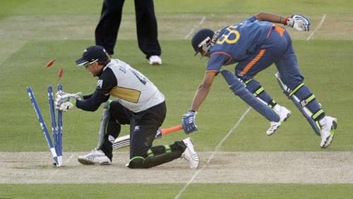 Ravindra Jadeja runs in safely to avoid being run out by New Zealand wicketkeeper Brendon McCullum during the Twenty20 World Cup warm-up match between India and New Zealand at Lord's cricket ground in London on Monday. (AP Photo)