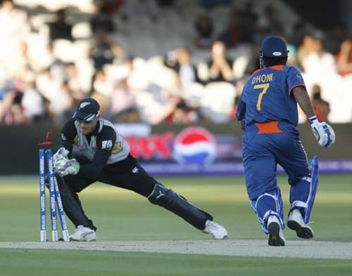 India's MS Dhoni is stumped by New Zealand's Brendon McCullum during their Twenty20 match prior to the start of the ICC World Twenty20 at Lord's cricket ground in London on Monday. (AFP Photo)