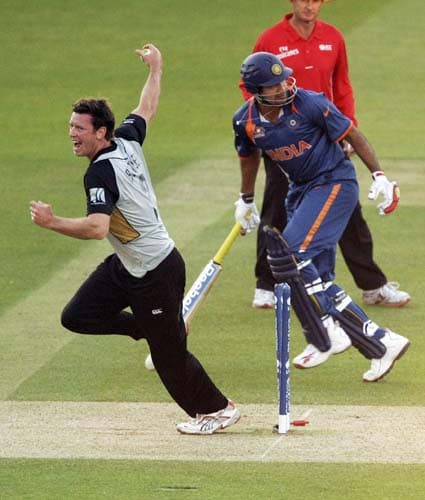 New Zealand's Ian Butler celebrates after running out India's Irfan Pathan during the Twenty20 World Cup warm-up match between India and New Zealand at Lord's cricket ground in London on Monday. (AP Photo)