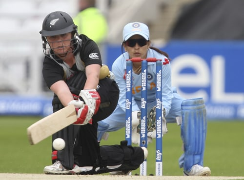 Lucy Doolan sweeps the ball watched by Sulakshna Naik during during their ICC World Twenty20 Women's semi-final match at Trent Bridge. (AP Photo)