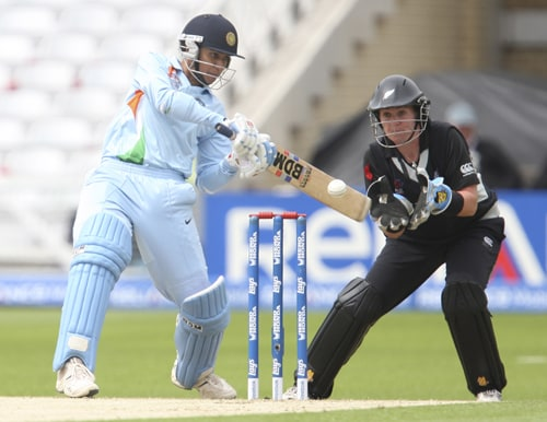 Anjum Chopra hits out against New Zealand as Rachel Priest looks on during their ICC World Twenty20 Women's semi-final match at Trent Bridge. (AP Photo)
