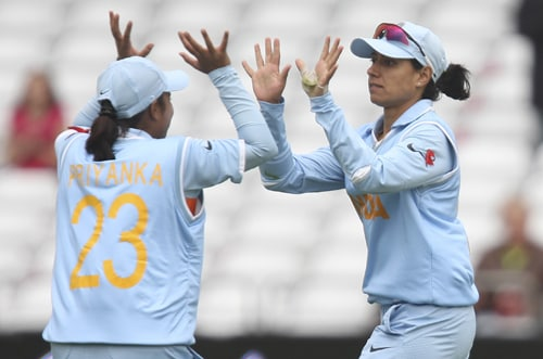 Anjum Chopra celebrates with team mate after taking the wicket of New Zealand's Lucy Doolan during their ICC World Twenty20 Women's semi-final match at Trent Bridge. (AP Photo)