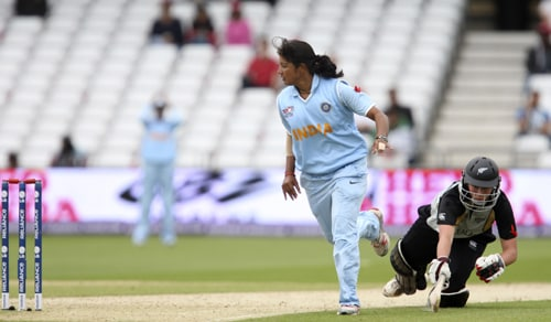 Aimee Watkins makes it back to the crease as Rumeli Dhar attempts a run out during their ICC World Twenty20 Women's semi-final match match at Trent Bridge. (AP Photo)