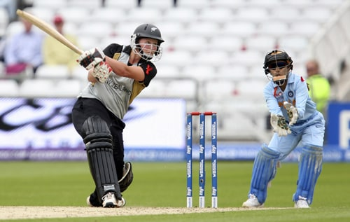 Aimee Watkins hits out against India as wicketkeeper Priyanka Roy looks on during their ICC World Twenty20 Women's semi-final match at Trent Bridge. (AP Photo)