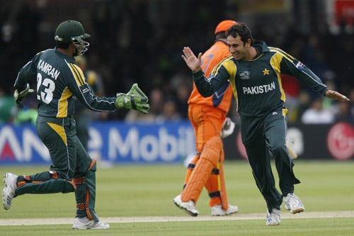Saeed Ajmal of Pakistan celebrates taking the wicket of Alexei Kervezee of Netherlands stumped by Kamran Akmal during their ICC World Twenty20 match at Lord's in London. (AFP Photo)