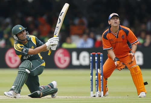 Kamran Akmal plays a shot that is caught out by Alexei Kervezee watched by Jeroen Smits during their ICC World Twenty20 match at Lord's in London. (AFP Photo)