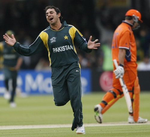 Saeed Ajmal of Pakistan celebrates taking the wicket of Alexei Kervezee during their ICC World Twenty20 match at Lord's in London. (AFP Photo)