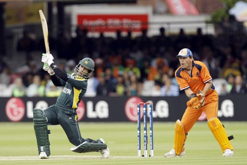 Salman Butt hits a shot watched by wicketkeeper Jeroen Smits during the ICC World Twenty20 match between The Netherlands and Pakistan at Lord's in London. (AP Photo)