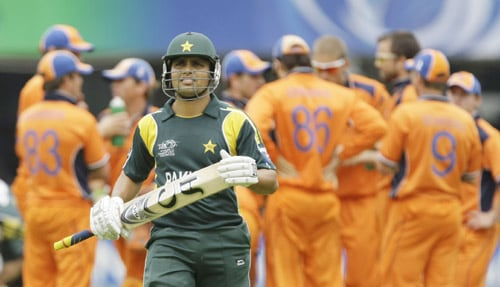 Kamran Akmal leaves the field after being caught out by Edgar Schiferli during ICC World Twenty20 match between the Netherlands and Pakistan at Lord's in London. (AP Photo)