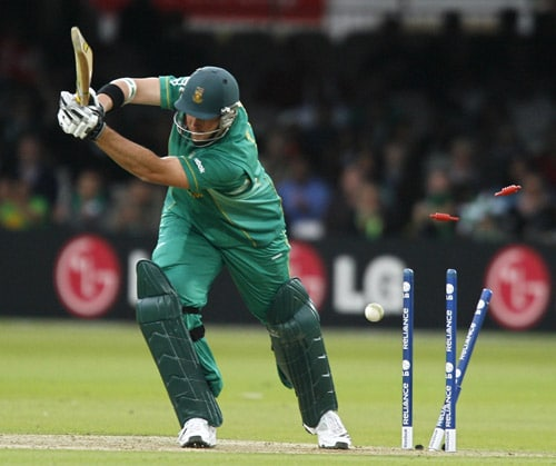 Graeme Smith is bowled by Ian Butler during their ICC World Twenty20 match at Lord's in London. (AFP Photo)