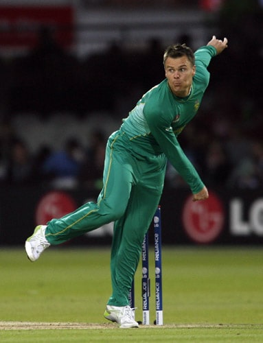 Johan Botha bowls against New Zealand during their ICC World Twenty20 match at Lord's in London. (AFP Photo)