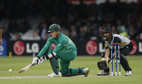 Johan Botha plays this reverse shot watched by Peter McGlashan during their ICC World Twenty20 match at Lord's in London. (AFP Photo)