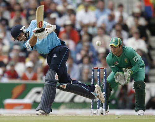Kyle Coetzer plays a shot as Mark Boucher looks on during their ICC World Twenty20 Cup match at the Oval ground in London. (AFP Photo)