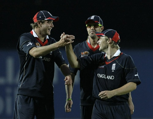 England's Stuart Broad, Kevin Pietersen and Luke Wright leave the field after defeating Pakistan in the Group B Twenty20 World Cup match at The Oval ground in London. (AP Photo)