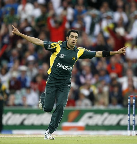 Umar Gul celebrates bowling Owais Shah during their ICC World Twenty20 Cup match at the Oval ground in London. (AFP Photo)
