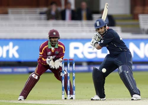 England's Ravi Bopara plays a shot off the bowling of West Indies' Sulieman Benn as wicket keeper Denesh Ramdin looks on during their warm-up Twenty20 World Cup match at Lord's cricket ground in London, on Wednesday. (AP Photo)