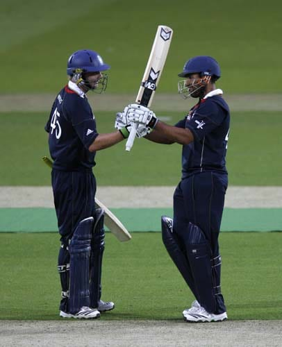Luke Wright of England congratulates Ravi Bopara of England on reaching 50 runs against West Indies during their Twenty20 match prior to the start of the ICC World Twenty20 at Lord's cricket ground in London, on Wednesday. (AFP Photo)