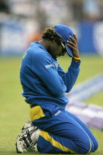 Lasith Malinga reacts after failing to stop the ball for a four against Pakistan during the ICC World Twenty20 final at Lord's. (AFP Photo)
