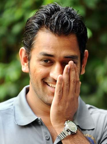 Mahendra Singh Dhoni smiles during the official team photo opportunity in Mumbai on May 29, 2009. Defending champions India leave for England to compete in the ICC World Twenty20 tournament scheduled from June 5-21. (AFP Photo)