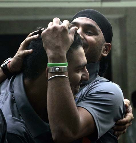 Yuvraj Singh and Harbhajan Singh embrace each other ahead of the team's departure for England for the Twenty20 World Cup tournament. Dhoni said he is confident that India can retain the Cup in England next month. (AP Photo)