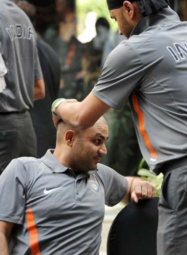Harbhajan Singh jokes with teammate Virender Sehwag during the official team photo opportunity in Mumbai. (AFP Photo)